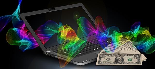 počítač, bankovky a barevné vlnění.jpg