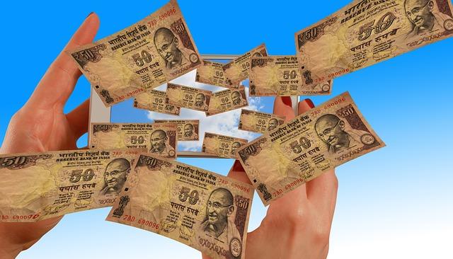 Bankovky vylétající z mobilního telefonu